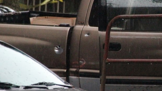 Bullet holes can be seen in the side of this truck after Surrey RCMP opened fire on it. Police say the vehicle had been ordered to stop, but attempted to flee, striking two police cruisers.