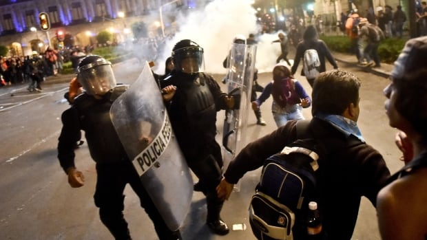 Protesters angry at the presumed massacre of 43 students clashed with police after a march demanding President Enrique Pena Nieto's resignation.