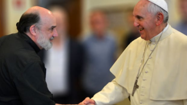 Pope Francis shakes hands with Rev. Robert Geisinger S.J., after choosing the American priest to investigate sexual abuse by Catholic priests worldwide.