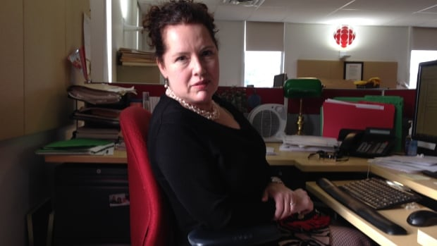 Chris O'Neill-Yates, at work at her desk in the CBC newsroom in St. John's, found herself a target for simply doing her job.