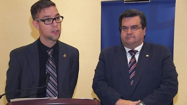 Denis Coderre looks on while Mascouche Mayor Guillaume Tremblay explains his position on TransCanada's Energy East pipeline plans.