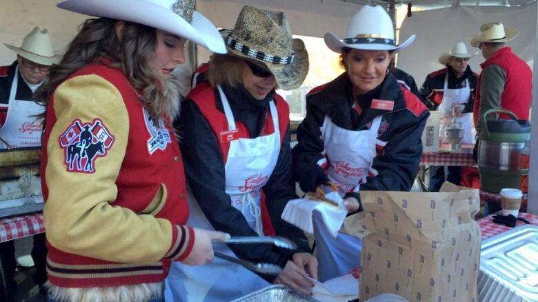 Calgary Stampeders Fans Hand Out Free Sausages During The