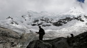 People walk near the Hualcan glacier in Ancash region, Peru.  The country is home to 70 per cent of the world's tropical glaciers, which are a source of fresh water for millions.