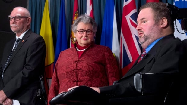 Senator Nancy Ruth and Senator Larry Campbell listen to Member of Parliament Steven Fletcher discuss the next step with physician-assisted death legislation during a news conference on Parliament Hill.