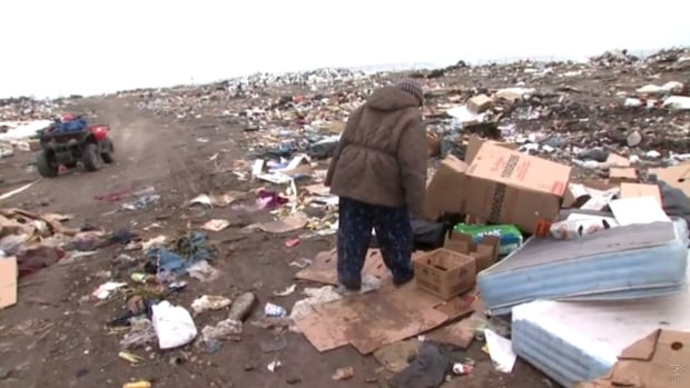 Lucy Wiebe scours the Rankin Inlet dump for salvageable goods in the APTN program, Wasting Away. The program ignited controversy by suggesting high food prices were forcing people to look for nourishment at the dump.