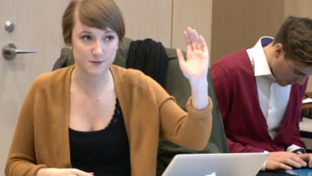 Edmonton Youth Council president Claire Edwards leads the debate over Bill 10 Wednesday night.