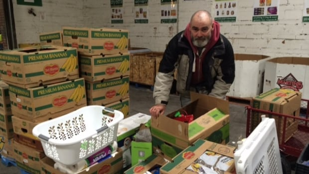 Volunteeer Calvin Carr sorts through donated goods at the Saskatoon Food Bank & Learning Centre.