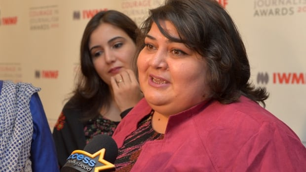 The Azerbaijani president's office accused journalist Khadija Ismayilova, right, of 'defiance' one day before she was arrested by authorities in Azerbaijan and jailed for two months.