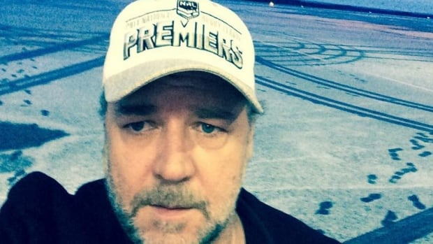Actor Russell Crowe takes a selfie as he gets off of his plane Sunday morning for a brief stop in Gander, Newfoundland. His friends Allan Hawco and Alan Doyle did not drive to the airport to meet him.