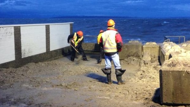 Crews in Tsawwassen repair a seawall after parts of it collapsed during the storm surge in December 2014.