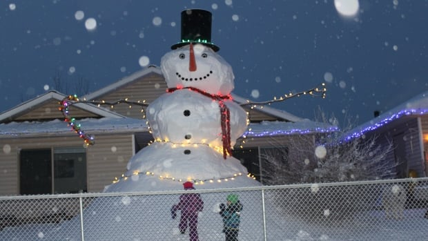 Lukas Mertelik used huge snowfall, steel rods and plywood to sculpt a giant snowman for his two children in Fort Nelson, B.C.