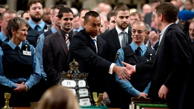 House of Commons Speaker Andrew Scheer, seen here shaking hands with Const. Samearn Son during a special House ceremony to honour efforts of Hill security guards on Oct. 22, has already written to RCMP Commissioner Bob Paulson about 'next steps' in having the Mounties take over policing on Parliament Hill.