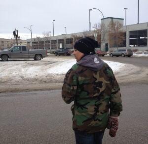 Simon Ash-Moccasin walks through downtown Regina