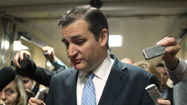 Senator Ted Cruz is surrounded by reporters on Capitol Hill on Friday night after the Texas tea-party favourite threw up a roadblock that prevented a vote on a $1.1 trillion government-wide spending bill. His motion was voted down Saturday night.