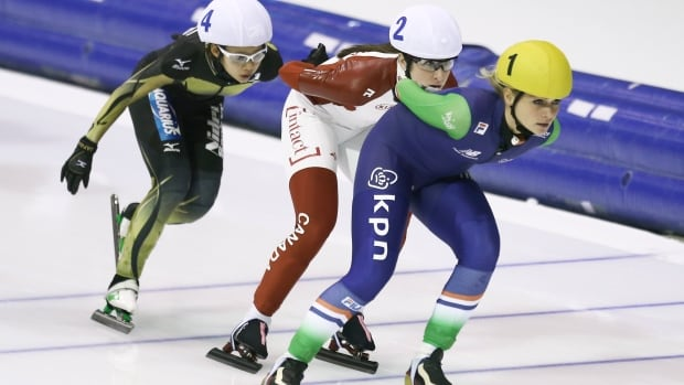 Japan's Nana Tagaki, left, Canada's Ivanie Blondin, center, and Irene Schouten of the Netherlands, right, compete in the women's mass start race of the World Cup Speed Skating at Thialf skating rink in Heerenveen, northern Netherlands, Sunday, Dec. 14, 2014.