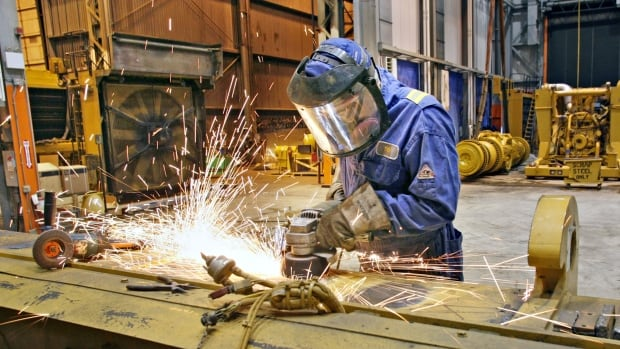 Albertans, such as this pipe welder in Fort McMurray, earn nearly 25 per cent more than the average Canadian. But that's starting to change following the decline in oil prices.