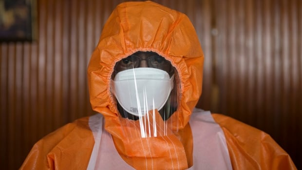 The World Health Organization has admitted several failings during the Ebola crisis. Here, a doctor in Sierra Leone wears protective clothing during a training practice at an Ebola Training Academy in Freetown.