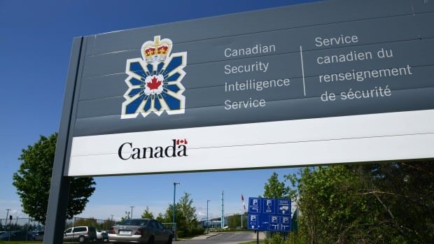 A sign for the Canadian Security Intelligence Service building is shown in Ottawa  May 2013. Human rights advocates say a practice by Canada's spy agency of revealing its interest in people to foreign partners after receiving assurances the individuals would not be tortured shirks the law.