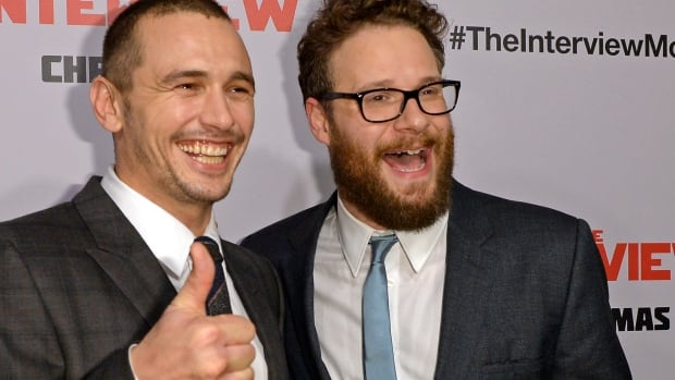 Cast members James Franco and Seth Rogen posed during premiere of the film The Interview in Los Angeles earlier this month. Broader theatrical release of the Sony Pictures film has now been halted.