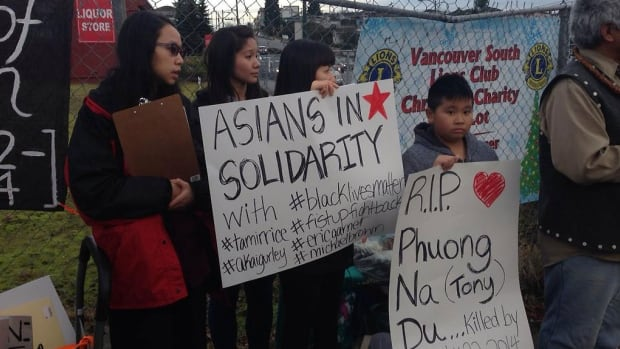 Members of Vancouver's Vietnamese community attend a vigil for Phung Na (Tony) Du, who was shot and killed by police one month ago after refusing to drop a two-by-four.