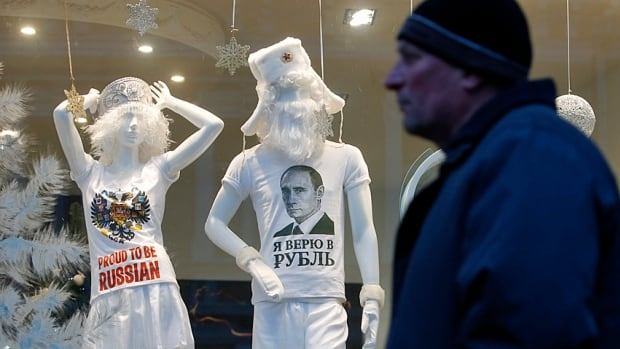 "Mannequins in a Moscow department store put on a brave face. The T-shirt reads, ""In Rouble I trust"". Many stores, though, have sales 70 and 90 per cent to move merchandise against the discounted currency."