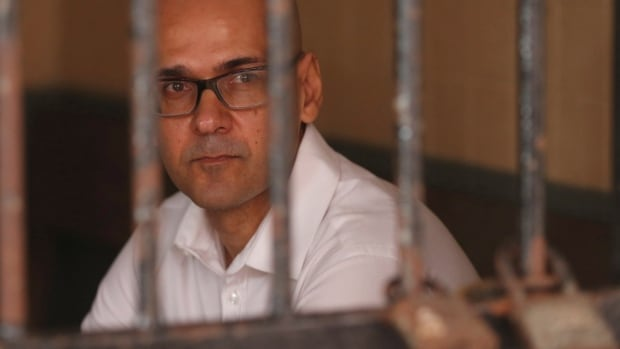Canadian teacher Neil Bantleman sits in a holding cell prior to the start of his trial hearing at South Jakarta District Court in Jakarta, Indonesia in December. The Bantleman family hope the outcome of a defamation case will help his appeal.