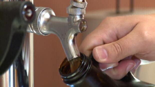 NB Liquor growler pouring