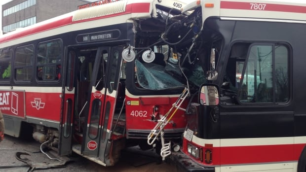 A TTC streetcar and a bus collided head-on at the intersection of Main Street and Danforth Avenue on Saturday morning. The bus driver, among four injured, has now been charged with careless driving.