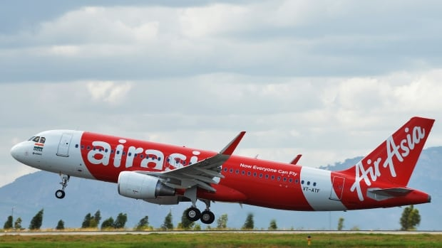 An AirAsia Airbus A320 takes off in June. An AirAsia flight from the Indonesian city of Surabaya to Singapore lost contact with air traffic control on Sunday.