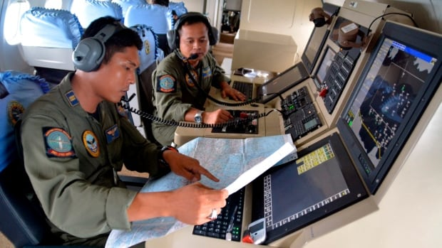 Members of the Indonesian Navy's Tactical Commanding Operator (TACCO) are among those helping to try and locate the missing AirAsia plane that disappeared Dec. 28 in the Java Sea.