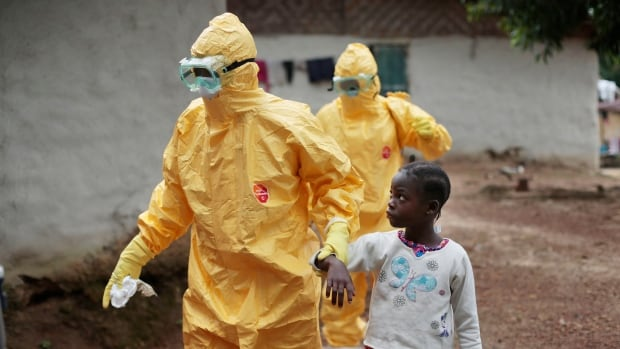 A Liberian girl is taken to an ambulance after showing signs of an Ebola infection. The World Health Organization says more than 8,000 people around the world died last year from the deadliest Ebola outbreak on record.