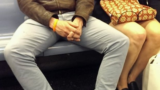 "This is one of dozens of photos posted on a tumblr page aimed at highlighting the problem of ""man-spreading."" Essentially man-spreading occurs when transit passengers, most often men, sit with their legs splayed out at the expense of passengers around them."