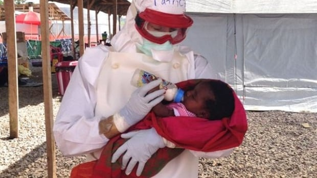 Patrice Gordon, a B.C. nurse practitioner and Red Cross delegate, has tested negative for Ebola. She is seen here caring  for a one-month-old baby with Ebola.