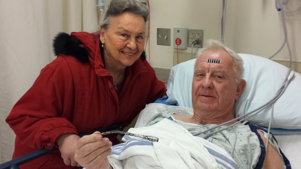 Arthur Lampitt and his wife Betty of Granite City, Ill., show off the 1963 Thunderbird turn signal that was embedded in his arm for 51 years, after having surgery to remove it on Dec. 31, 2014.