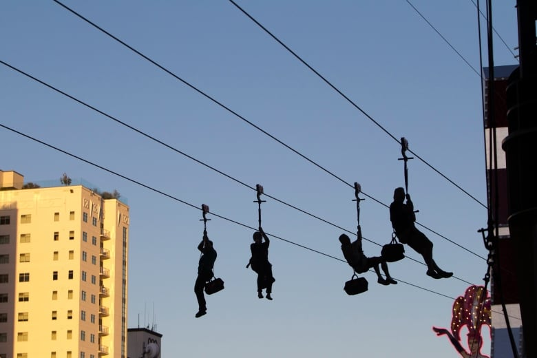 Canadian tourist rescued from zip line high above Las Vegas street ...