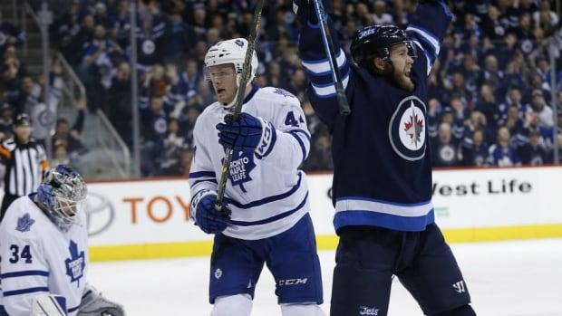 Winnipeg's Matt Halischuk, right, celebrates his goal against the Toronto Maple Leafs on Saturday.