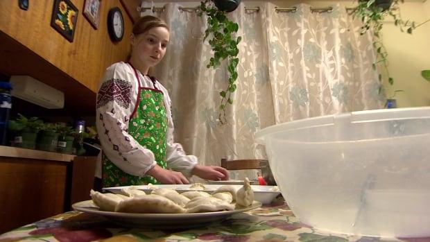 Valentyna Drozdovskyy is helping her mom make potato onion perogies for their Orthodox Christmas dinner on January 6.