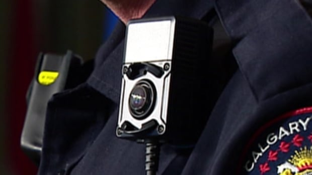 Officer body cameras like this one, worn by an officer in Calgary, were supposed to be attached to some Winnipeg Police Service officers this year as part of a pilot project.