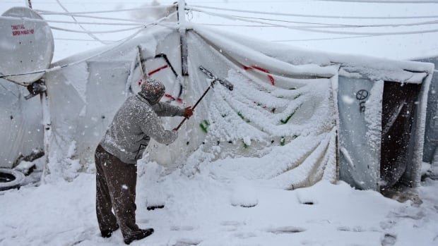 While daily life in Lebanon's Bekaa Valley ground to a halt due to the winter storm, hundreds of thousands of Syrian refugees struggled to find warmth.