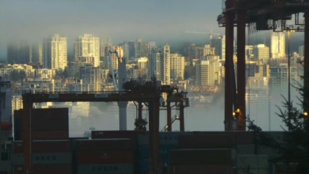 Sun peeked through the low fog in Vancouver Wednesday morning.