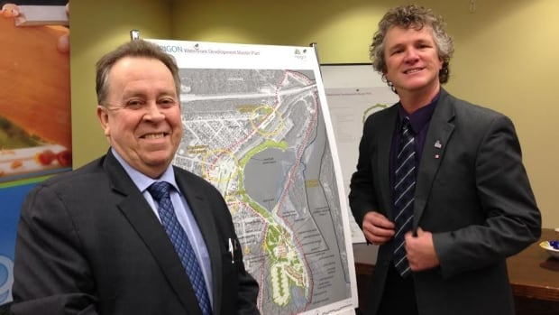 Northern Development Minister Michael Gravelle and Nipigon Mayor Richard Harvey stand in front of an image of the Nipigon waterfront development plan, at the town offices on Wednesday.