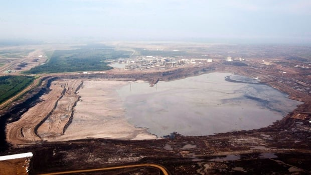 An aerial view shows a tailings pond near Fort McMurray, Alta. Canada has succeeded in blocking an investigation of the tailings ponds by NAFTA's environmental watchdog.