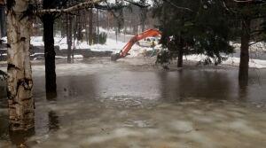 Flooded beach area in Muskoka town of Rosseau