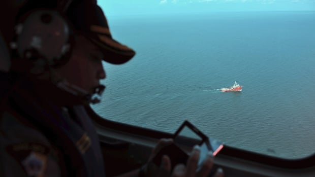 A day after the tail of the crashed AirAsia plane was fished out of the Java Sea, the search for the missing black boxes intensified Sunday with more pings heard.
