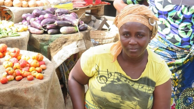 Kadiatu Sesay watches over her vegetable stand in Kroo Town market in Freetown.  Since the Ebola virus came to Sierra Leone, her sales have been cut in half or worse.