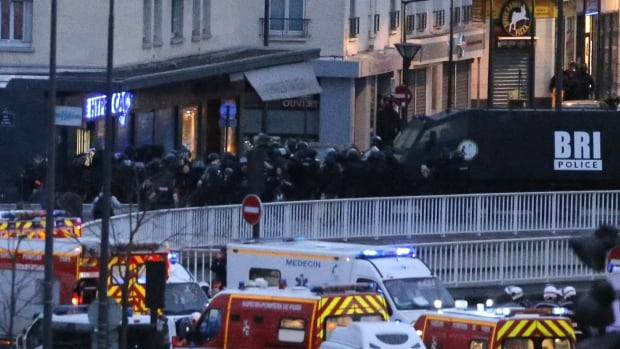 Police storm the kosher market where a gunman held several hostages in Paris. The assault came after a quick-thinking Muslim employee hid  several Jewish shoppers in the basement before sneaking out to brief police on the hostage-taker upstairs.