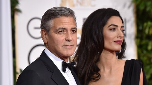 George Clooney, seen in 2015 with his wife Amal, is blasting a French magazine for its 'illegally' obtained images of the couple with their newborn twins.