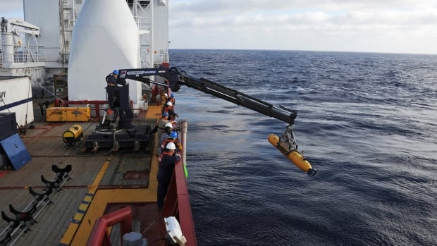 Operators aboard the Australian Defence Vessel Ocean Shield move an underwater vehicle from the U.S. Navy into position for deployment in the Southern Indian Ocean as part of the search for Malaysia Airlines Flight 370 last April.