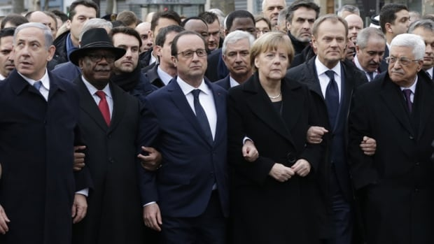 French President Francois Hollande is surrounded by heads of state including, from left to right: Israel's Prime Minister Benjamin Netanyahu, Mali's President Ibrahim Boubacar Keita, Germany's Chancellor Angela Merkel, European Council President Donald Tusk and Palestinian President Mahmoud Abbas. Some rights groups have noted that many international representatives at the Paris rally represented nations with poor records on free expression.