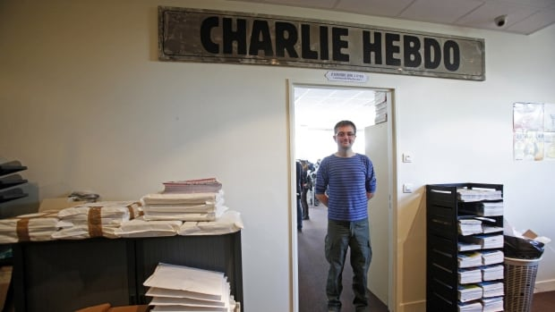 French cartoonist Stephane Charbonnier, publishing director of French satirical weekly Charlie Hebdo, poses for photographs at their Paris offices on Sept. 19, 2012. Charb, as he was familiarly known, was one of 12 killed in the office attack.